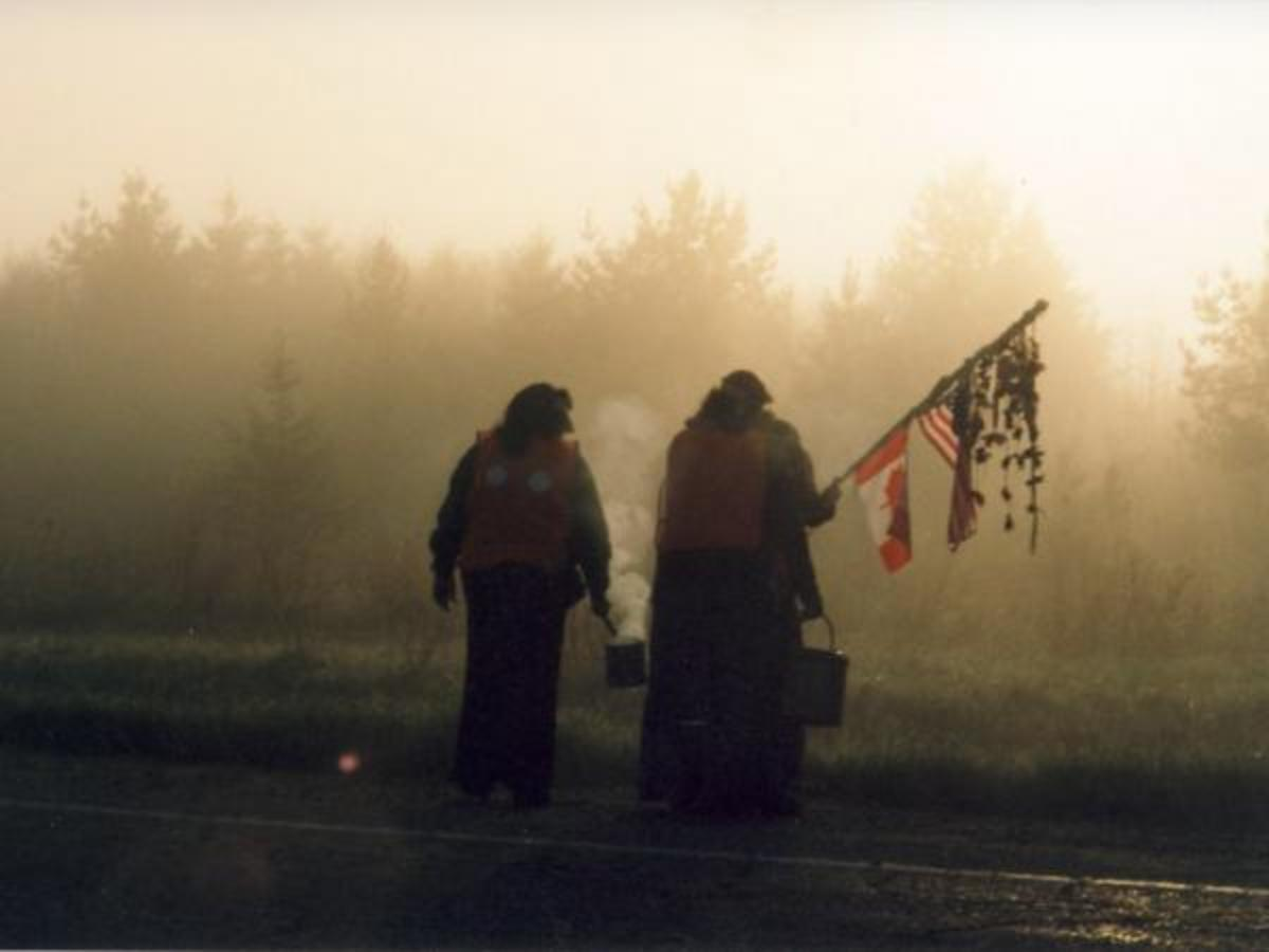 """Participants in the annual Mother Earth Water Walk wend their way around a different Great Lake each year and up the St. Lawrence River Seaway. The Anishinaabe walkers embrace the theme of the walks, which started in 2003: """"Ni guh Izhi chigay Nibi onji."""" (""""I will do it for the water."""")"""