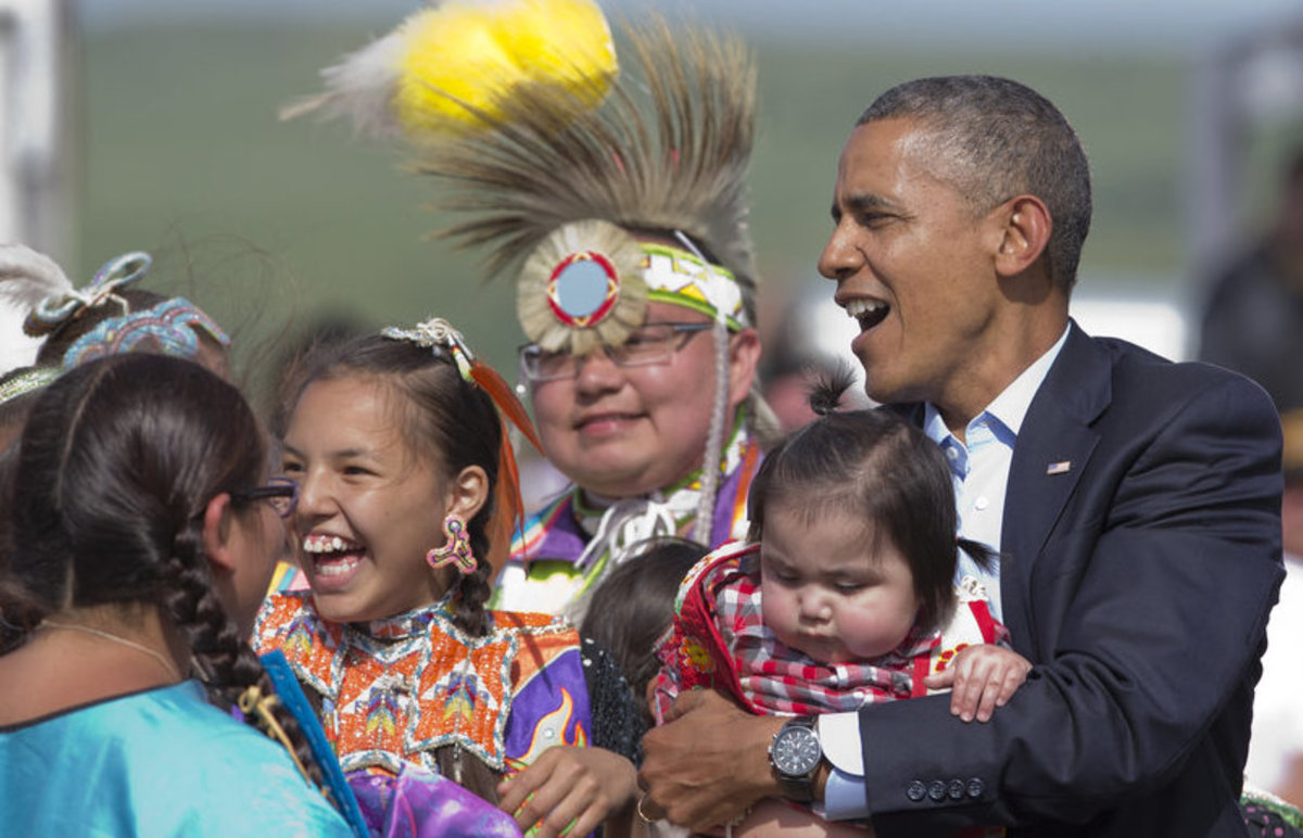 President Barack Obama held a Native baby during his visit to the Standing Rock Sioux Tribal Nation, in Cannon Ball, N.D., Friday, June 13, 2014. It was his first trip to Indian Country as president and only the third such visit by a sitting president in almost 80 years.