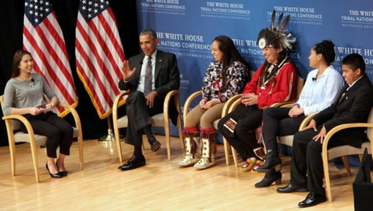 President Barack Obama surprised an auditorium filled with tribal leaders, government department officials, reporters and Native youth on Thursday Nov. 5, 2015, when arrived earlier than expected and walked on stage to join five native youth