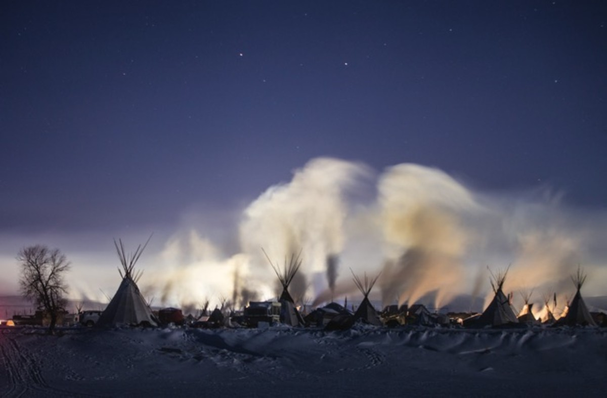 The Horn at night. The Horn, a traditional camp layout where seven tipis are placed in a circle formation, represents the historic and symbolic political organization of the Oceti Sakowin.