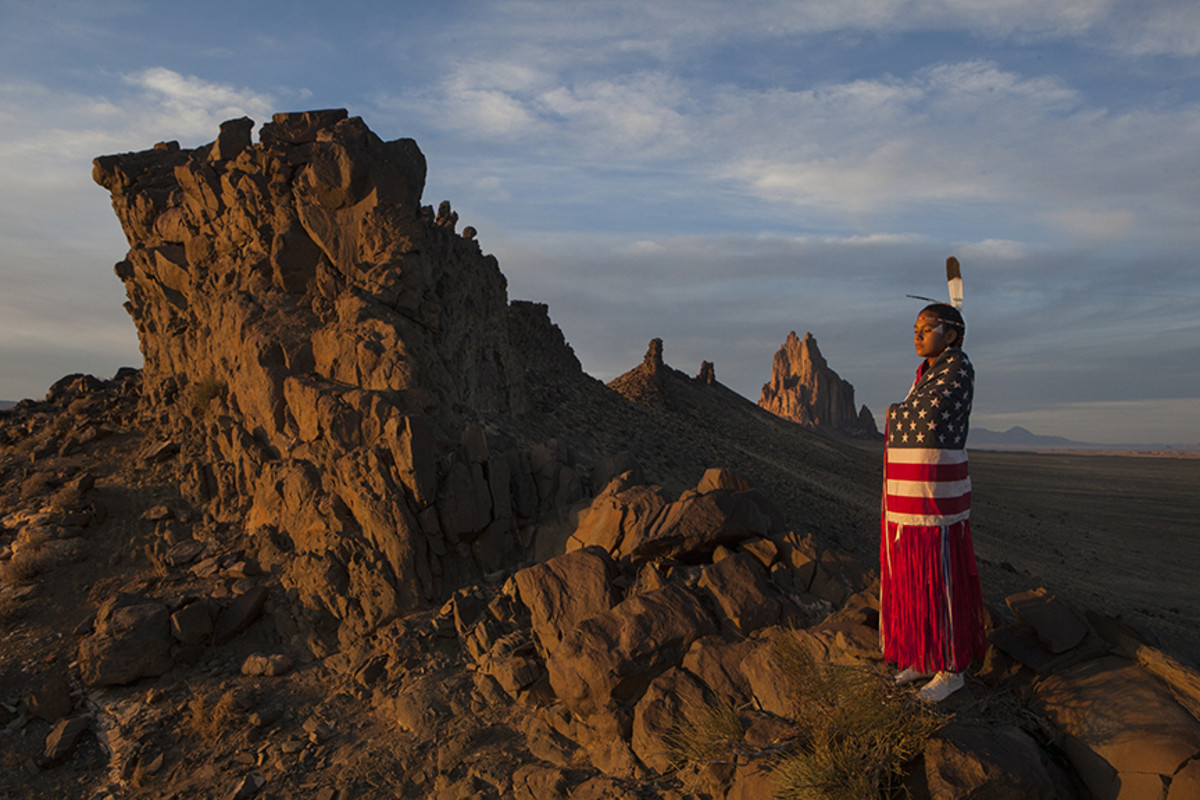 Fancy shawl dancer Veronica Toledo in the western spine of the Shiprock.Diego James Robles
